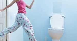 woman running to the toilet because of overactive bladder symptoms