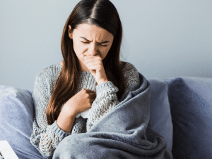 woman suffering from Cystic Fibrosis and Urinary Incontinence coughing