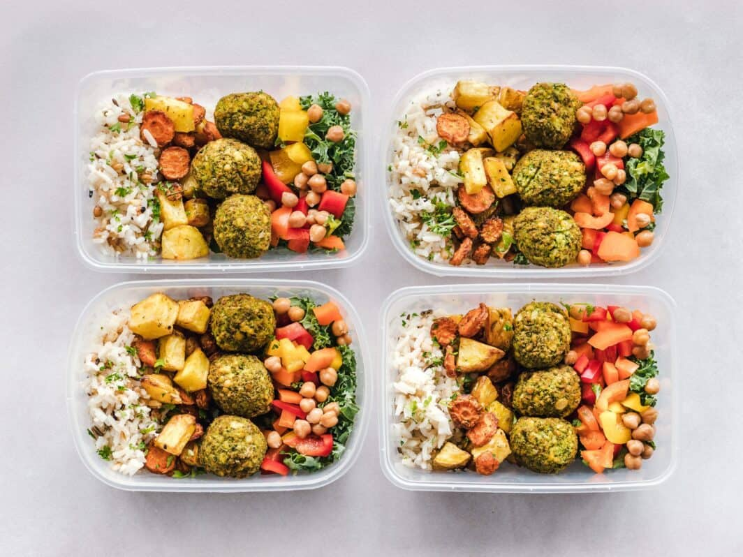 four plastic containers of prepared healthy meals