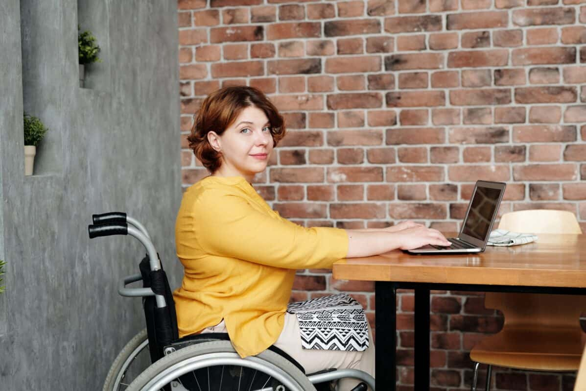 woman in a wheelchair working on a computer